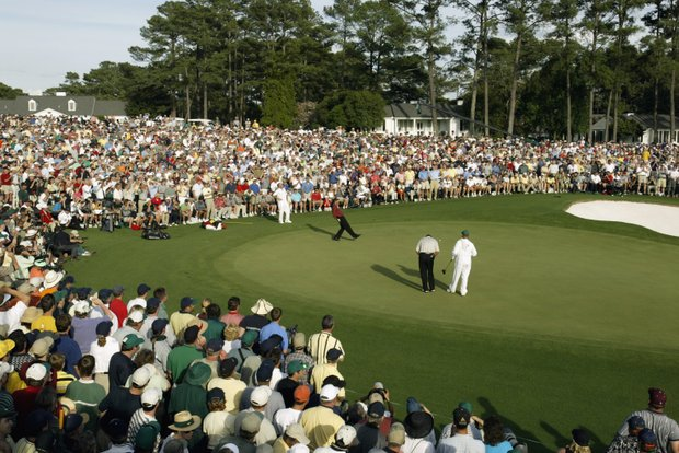 AUGUSTA, GA - APRIL 14: Tiger Woods of the USA urges a putt to drop on the18th green during the Masters Tournament at the Augusta National Golf Club in Augusta, Georgia on April 14, 2002.