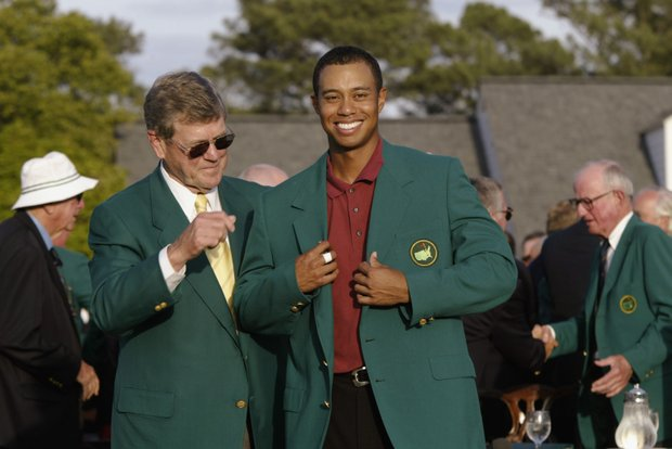 AUGUSTA, GA - APRIL 14: Tiger Woods of the USA is presented with his green jacket by Chairman of Augusta National Hootie Johnson after winning the Masters Tournament at the Augusta National Golf Club in Augusta, Georgia on April 14, 2002