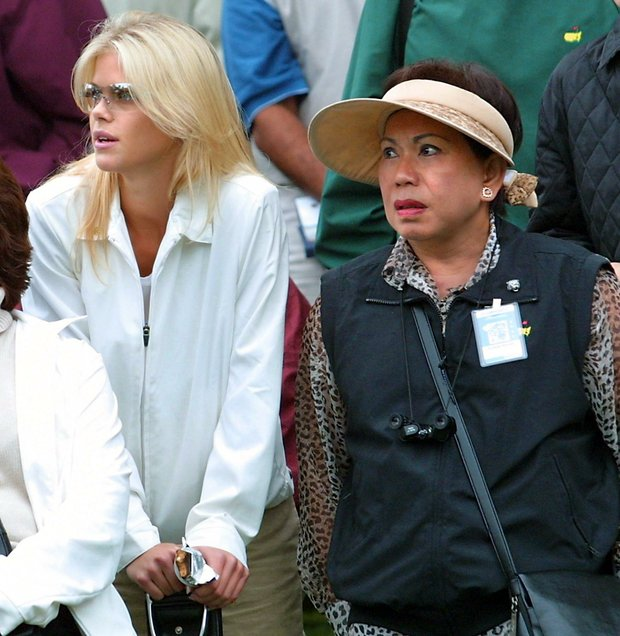 Elin Nordegren (L), ex-wife of US golfer Tiger Woods, and Woods' mother Kultida (R) watch from the gallery, 11 April 2002, during the opening round for the 2002 Masters Tournament at the Augusta National Golf Club in Augusta, GA.