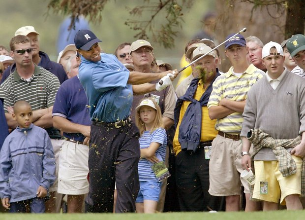 AUGUSTA, : Tiger Woods of the US hits out of the rough, 11 April 2002, during the opening round for the 2002 Masters Tournament at the Augusta National Golf Club in Augusta, GA. Woods finished the round at two-under par.
