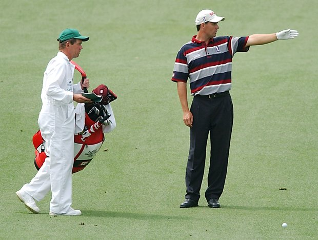 AUGUSTA, : Padraig Harrington (R) of Ireland points to his caddie Dave McNeilly (L) on the ninth hole, 11 April, 2002 during the first round of the Masters golf tournament at Augusta National Golf Club, in Augusta, GA.