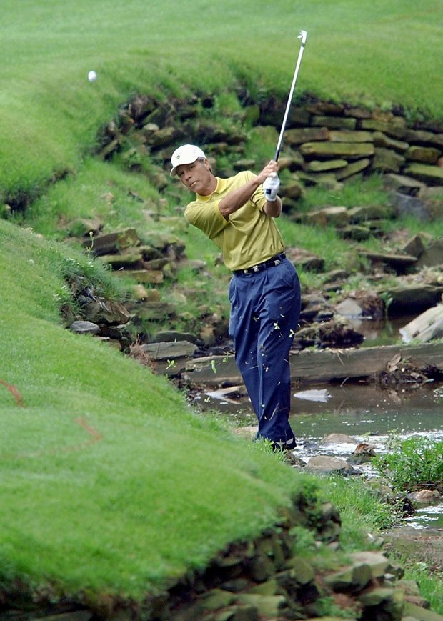 AUGUSTA, : Ben Crenshaw of the US hits out of Raes Creek, 11 April 2002, during the opening round for the 2002 Masters Tournament at the Augusta National Golf Club in Augusta, GA. Crenshaw finished the day at nine over par.