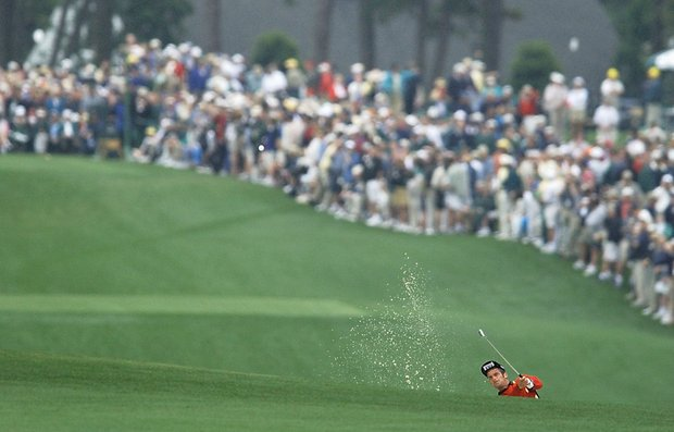 AUGUSTA, : Jjesper Parnevik of Sweden hits out a fairway bunker on the first hole 11 April 2002, during the opening round for the 2002 Masters Tournament at the Augusta National Golf Club in Augusta, GA.