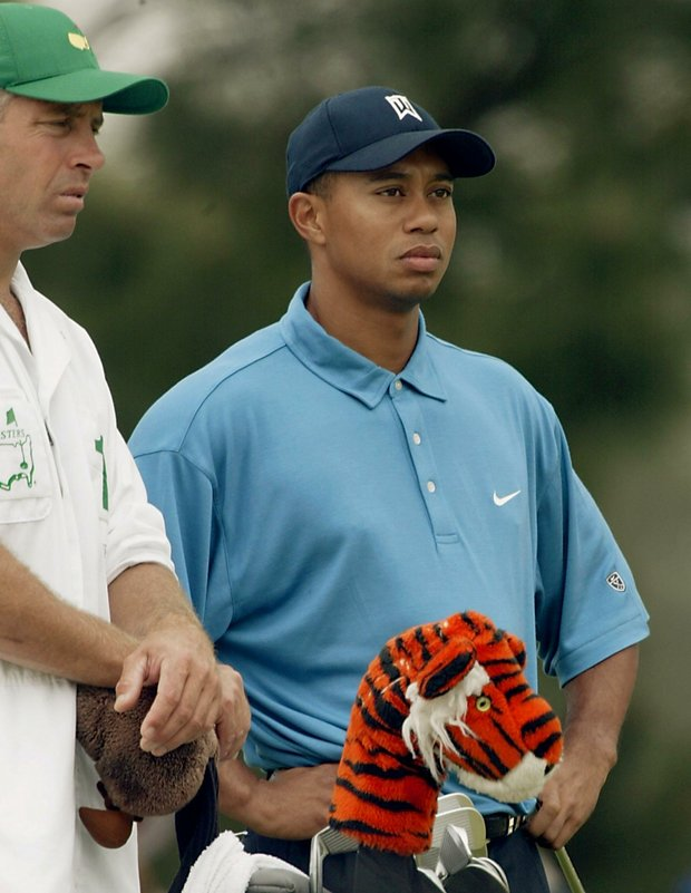 AUGUSTA, : Tiger Woods (R) of the US and caddy Steve Williams wait to tee off on the seventh hole 11 April 2002, during the opening round for the 2002 Masters Tournament at the Augusta National Golf Club in Augusta, GA.