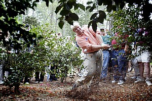11 Apr 2002: John Daly of the USA plays out of the trees on the 10th hole during the first day of the Masters Tournament from the Augusta National Golf Club in Augusta, Georgia.
