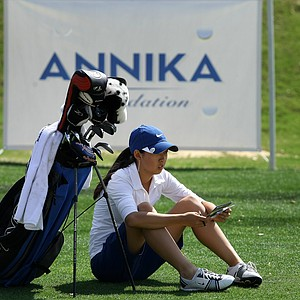 Paige Lee waits at No. 15 to hit her shot during the final round.