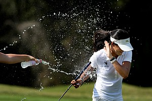 Celine Boutier of Montrouge, France, is doused with water and champagne after winning the Annika Invitationa. She won with a tournament total of 213.