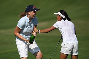 Perrine DeLacour of the French national team douses her teammate, Celine Boutier, with champagne after the final round.