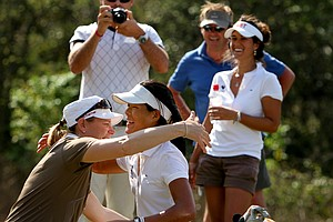 Annika Sorenstam gives a hug to Celine Boutier after she was doused with champagne and water after she won the Annika Invitational.