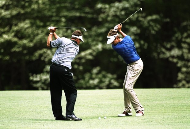 8 Apr 1998: Phil Mickelson and Davis Love III both of the USA hit the ball at the same time during the US Masters at Augusta National Golf Club in Georgia, USA.