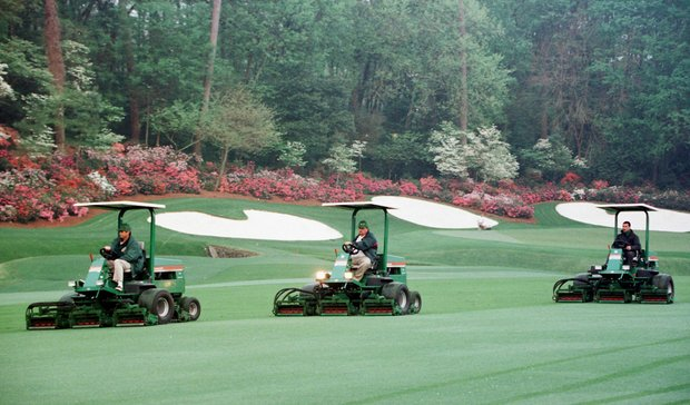AUGUSTA, : Course workers mow the thirteenth fairway early in the morning in preparation for the final practice round for the 1998 Masters golf tournament 08 April at the Augusta National Golf Course in Augusta, GA. The tournament starts 09 April.