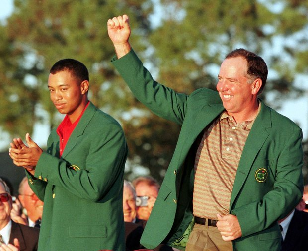 AUGUSTA, : Mark O'Meara (R) of the US pumps his fist in the air after getting the Green Jacket from Tiger Woods, the defending Masters champion, 12 April at Augusta National Golf Course in Augusta, GA. O'Meara finished at nine under par.