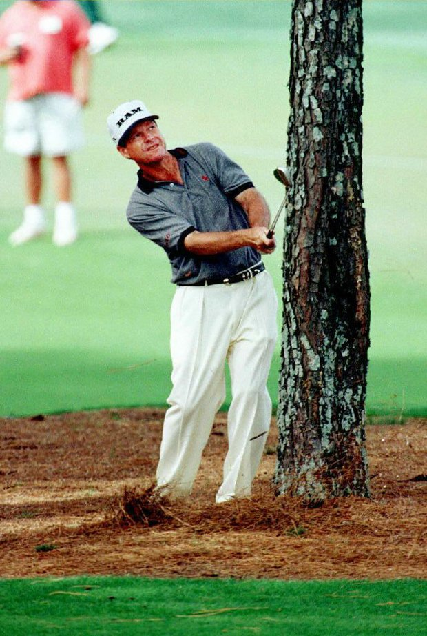 AUGUSTA, : Tom Watson of the US hits out of the trees on the seventh hole 13 April during the final round of the Masters tournament at Augusta National Golf Club in Georgia. Watson is tied for second place in the tournament at six-under-par.