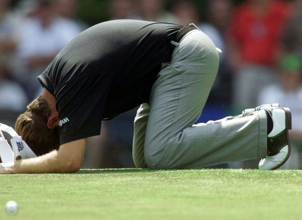 AUGUSTA, : Lee Westwood of England falls to his knees after missing a putt on 10 April 1999, during the third round of the Masters golf tournament at Augusta National Golf Club in Augusta, Georgia.