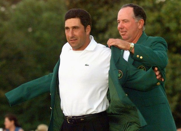 AUGUSTA, : 1999 Masters Champion Jose Maria Olazabal (R) of Spain get his green jacket for winning the Masters golf tournament from 1998 Masters Champion Mark O'Meara of the US (L) 11 April 1999, at Augusta National Golf Club in Augusta, Georgia. Olazabal shot a one-under-par 71 for a four-day total of 280, eight-under-par, to win the tournament.