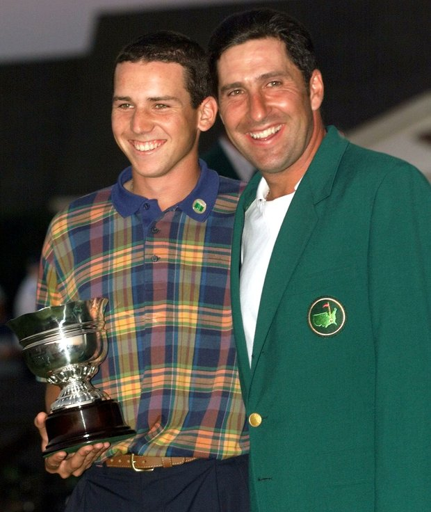 AUGUSTA, : 1999 Masters Champion Jose Maria Olazabal of Spain (R) stands with compatriot Sergio Garcia (L) after the Masters golf tournament 11 April 1999, at Augusta National Golf Club in Augusta, Georgia. Olazabal shot a one-under-par 71 for a four-day total of 280, eight-under-par, to win the tournament. Garcia was low amateur for the tournament.