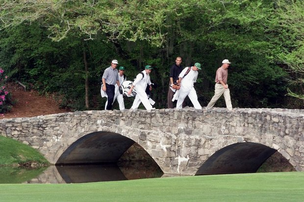AUGUSTA, : 1998 Masters Champion Mark O'Meara (R) of the US leads his playing partners Hank Kuehne (C) of the US, Lee Westwood (L) of England and their caddies across the bridge on the 13th hole 08 April 1999 during the first round of the Masters golf tournament at the Augusta National Golf Club in Augusta, Georgia.