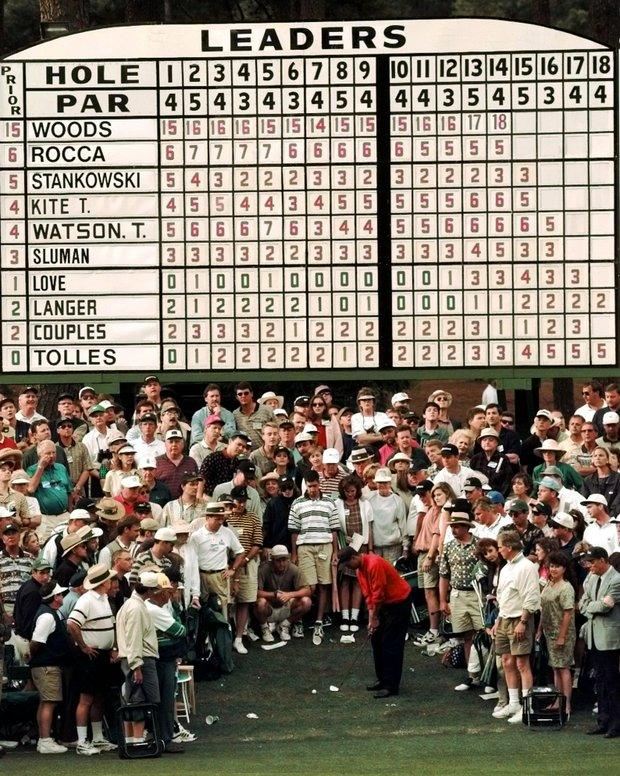 Tiger Woods hits from the gallery area on the 15th hole during final round Masters play at the Augusta National Golf Club in Augusta, Ga., Sunday, April 13, 1997.