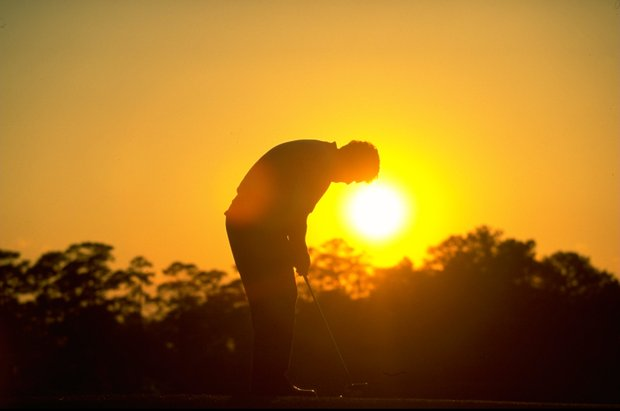 9 Apr 1998: Colin Montgomerie of Scotland putts on the green as the sun sets during the US Masters at Augusta National Golf Club in Georgia, USA.