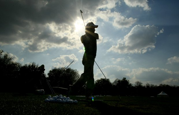 Ho Joon Choi works on his swing in the late afternoon sun. Choi and 15 other RNY students made the trek from Seoul to Orlando.