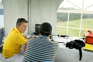 Robin Symes and Nam Kyu Ha in the video room, housed in a tent, on the driving range.