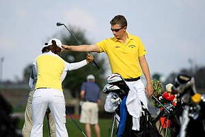 Robin Symes works with Ba Reum Choi on her swing.