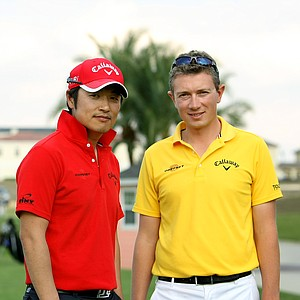 Robin Symes, right, and Young Jei Kim, left, of RNY Golf Institute, the RNY Institute is situated in Incheon, Korea, on the Sky 72 driving range, the largest range in the world.