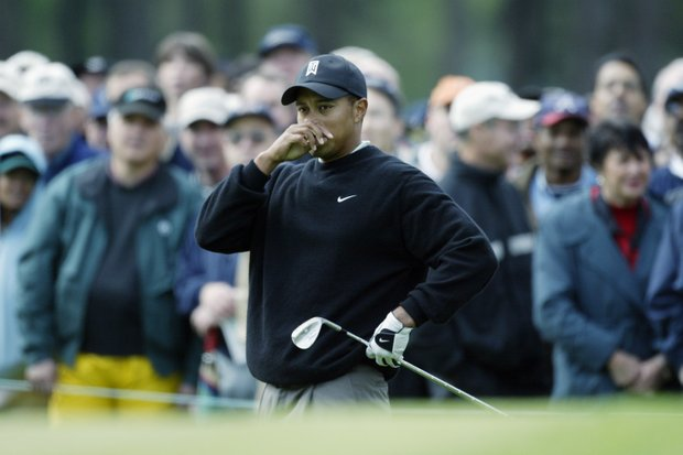 Tiger Woods of the USA after his chip shot on the first hole during the first round of the 2003 Masters Tournament at the Augusta National Golf Club in Augusta, Georgia on April 11, 2003.