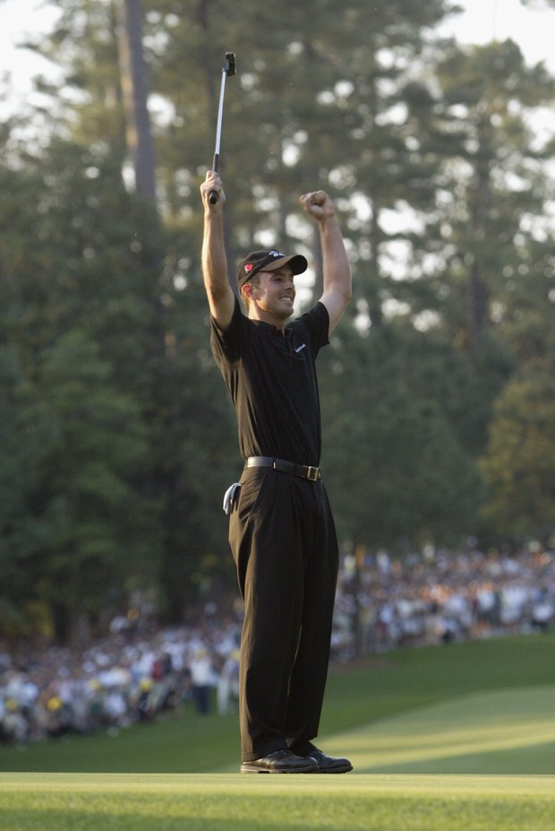 Mike Weir of Canada celebrates on the 10th green after winning the play off after the final round of the 2003 Masters Tournament at the Augusta National Golf Club in Augusta, Georgia on April 13, 2003.