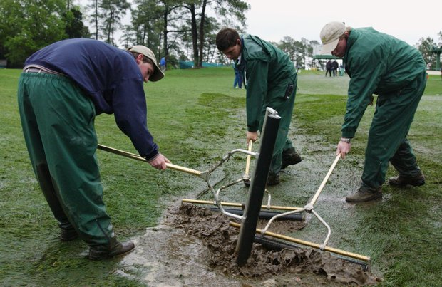 AUGUSTA, GA - APRIL 10: Greenkeepers clear the water off the course before play can start during the first day of the 2003 Masters Tournament at the Augusta National Golf Club in Augusta, Georgia on April 10, 2003.