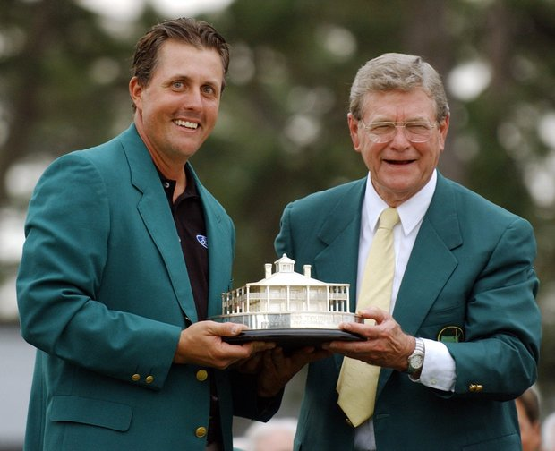 Phil Mickelson (L) of the US receives trophy for winning the Masters Golf Tournament from Augusta National Chairman Hootie Johnson (R) at the awards ceremony after Mickelson made the birdie putt the 18th green during the final round of the Masters Golf Tournament 11 April 2004 at Augusta National Golf Club in Augusta, GA. Mickelson won the tournament at nine under par.