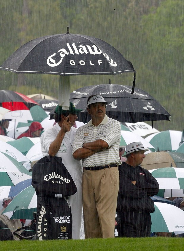 Eduardo Romero of Argentina shelters from the rain on the 12th tee during the first round of the Masters at the Augusta National Golf Club on April 8, 2004 in Augusta, Georgia.