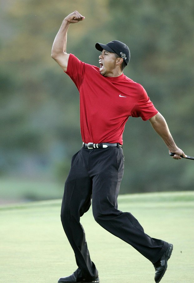 US golfer Tiger Woods celebrates after making the winning putt 10 April 2005 during the final round of the 2005 Masters Golf Tournament at the Augusta National Golf Club in Augusta, Georgia. Woods beat fellow American Chris DiMarco in a one-hole playoff.