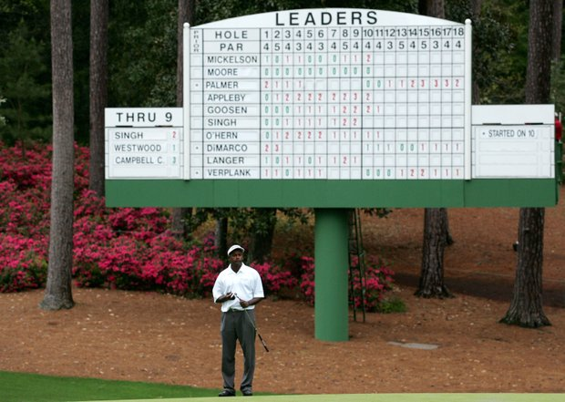 Vijay Singh of Fiji stands in front of the leaderboard on the tenth hole during the first round of The Masters at the Augusta National Golf Club on April 7, 2005 in Augusta, Georgia.