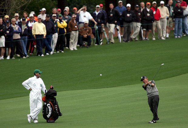 Gary Player of South Africa acknowledges hits a shot on the second hole during the first round of The Masters at the Augusta National Golf Club on April 7, 2005 in Augusta, Georgia.