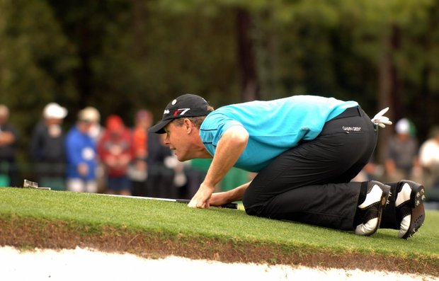 Joakim Haeggman of Sweden lines up a putt 07 April 2005 during the 1st round of the 2005 Masters Golf Tournament at the Augusta National Golf Club in Augusta, Ga.