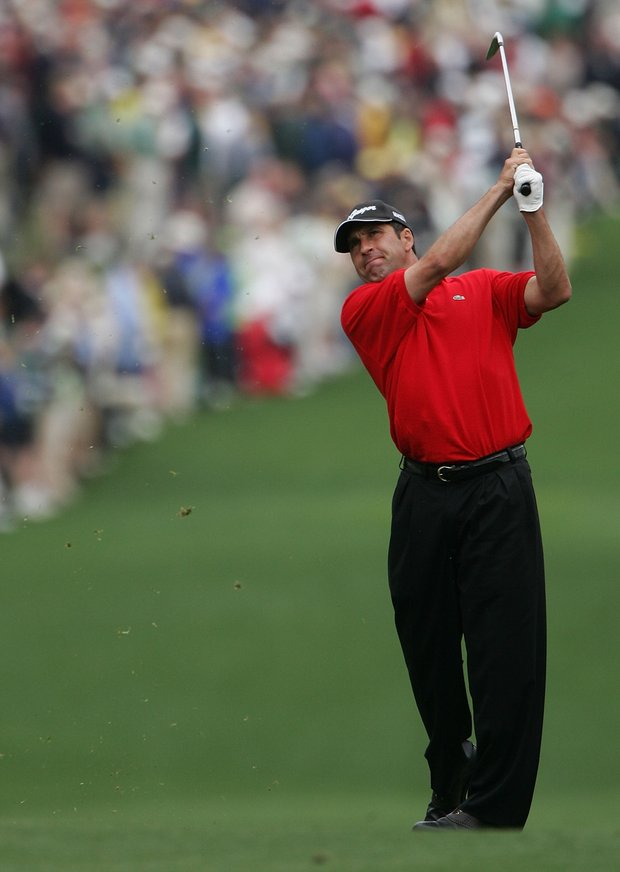 Jose Maria Olazabal of Spain watches his approach shot on the first hole during the first round The Masters at the Augusta National Golf Club on April 7, 2005 in Augusta, Georgia.