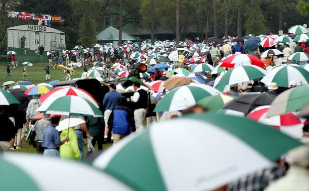 Patrons leaves the golf course during the weather-delayed second round at The Masters at the Augusta National Golf Club on April 8, 2005 in Augusta, Georgia.