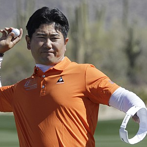 Y.E. Yang throws his ball to the crowd after winning 1 up in 20 holes over Alvaro Quiros.