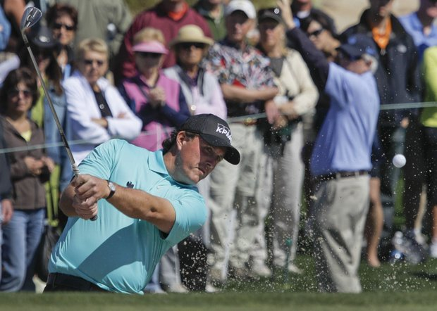 Phil Mickelson hits out of a sand trap on the seventh hole while playing Brendan Jones during the first round of the Accenture Match Play Championship.