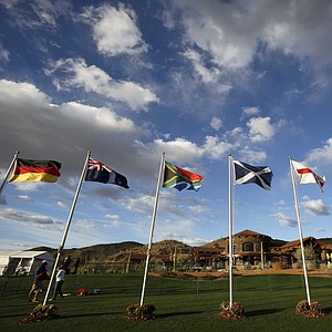 Flags of different countries representing golfers participating in the Match Play Championship.