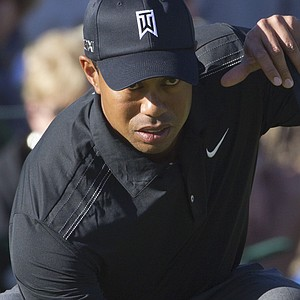 Tiger Woods lines up a putt on the 17th green while playing Thomas Bjorn during the first round of the Match Play Championship.