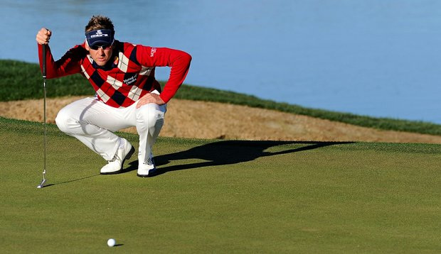 Ian Poulter lines up a putt on the third hole during the first round of the Accenture Match Play Championship at the Ritz-Carlton Golf Club.