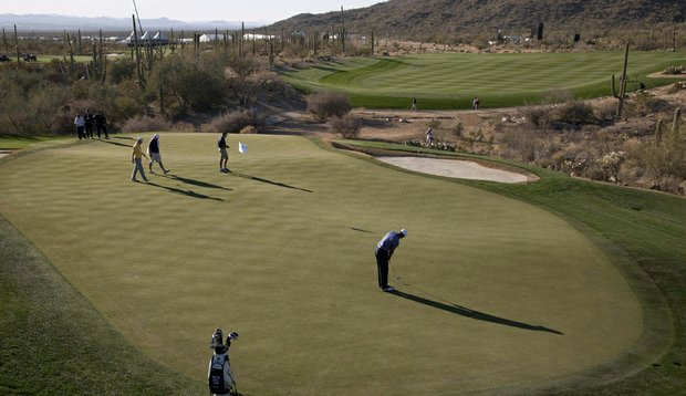 Tiger Woods putts during a practice round for the WGC-Accenture Match Play Championship.