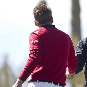 Stewart Cink, right, shakes hands with Ian Poulter after beating Poulter in 19 holes during the first round of the WGC Match Play Championship.