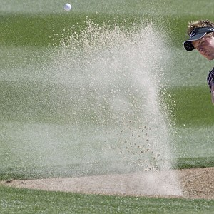 Luke Donald hits out of a sand trap on the 11th hole while playing Edoardo Molinari during the second round of the Match Play Championship.
