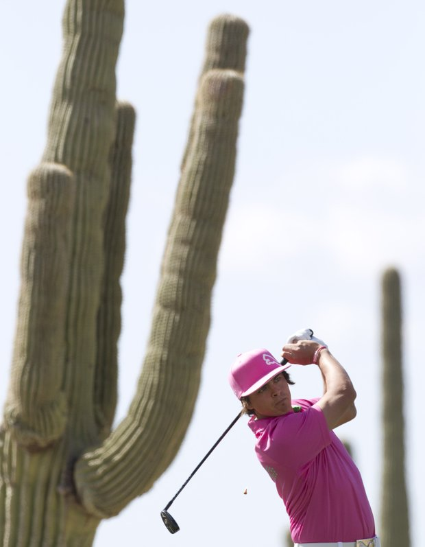 Rickie Fowler tees off the fourth hole while playing Phil Mickelson during the second round of the Match Play Championship on Thursday, Feb. 24, 2011, in Marana, Ariz.