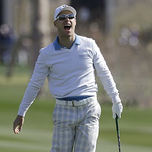 Ben Crane reacts after hitting an approach shot on the second hole while playing Rory McIlroy during the second round of the Match Play Championship.