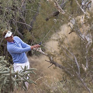 Luke Donald of England hits out of the rough on the 11th hole while playing Bubba Watson during the semifinals of the Match Play Championship golf tournament Saturday, Feb. 26, 2011, in Marana, Ariz.