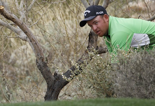 J.B. Holmes prepares to hit from the rough on 18 while playing Bubba Watson during a quarterfinal round of the Match Play Championship golf tournament Saturday, Feb. 26, 2011, in Marana, Ariz. Watson won 1 up in 19 holes.